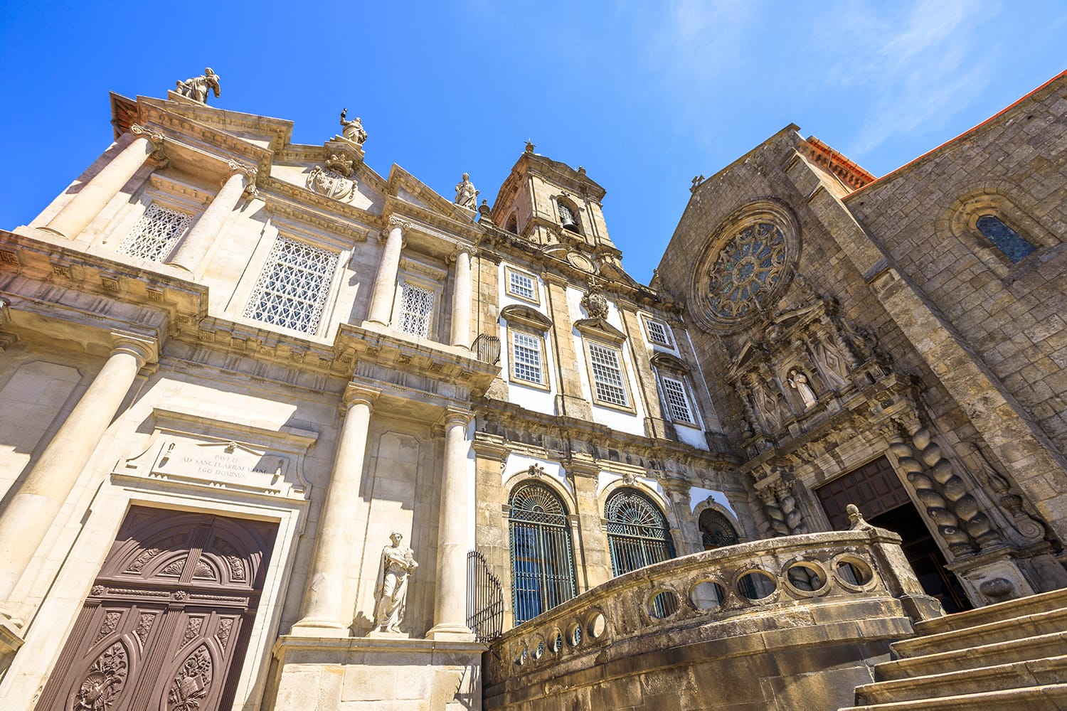 Prospective view of baroque main portal and gothic rose window of main facade of Church of Third Order of St. Francis or Igreja da Ordem Terceira de Sao Francisco. Ribeira district in Porto, Portugal