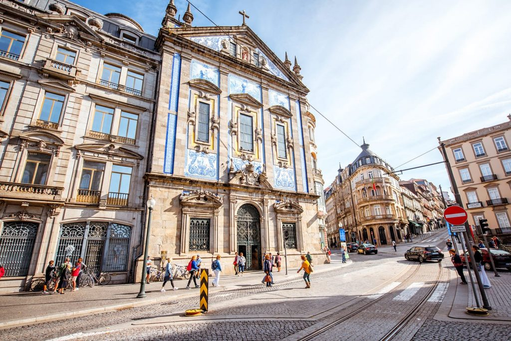 Street view on the facade with beautiful blue tiles of Congregados church in Porto city, Portugal