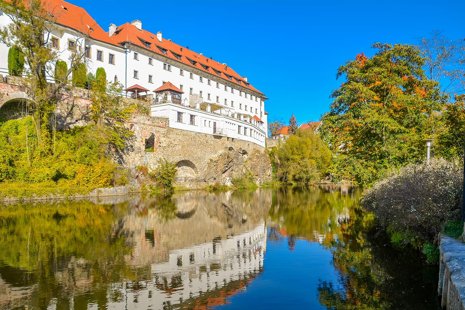 Embankment of Vltava River in Cesky Krumlov. Krumlov is town in South Bohemian Region of Czech Republic. Its historic centre, centred around Cesky Krumlov Castle.