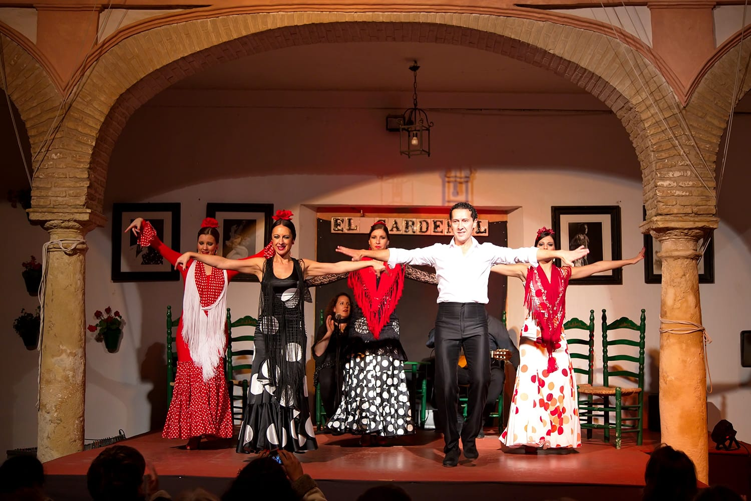 Flamenco dancers and singers performing at Tablao El Cardenal Flamenco Show in Cordoba, Spain