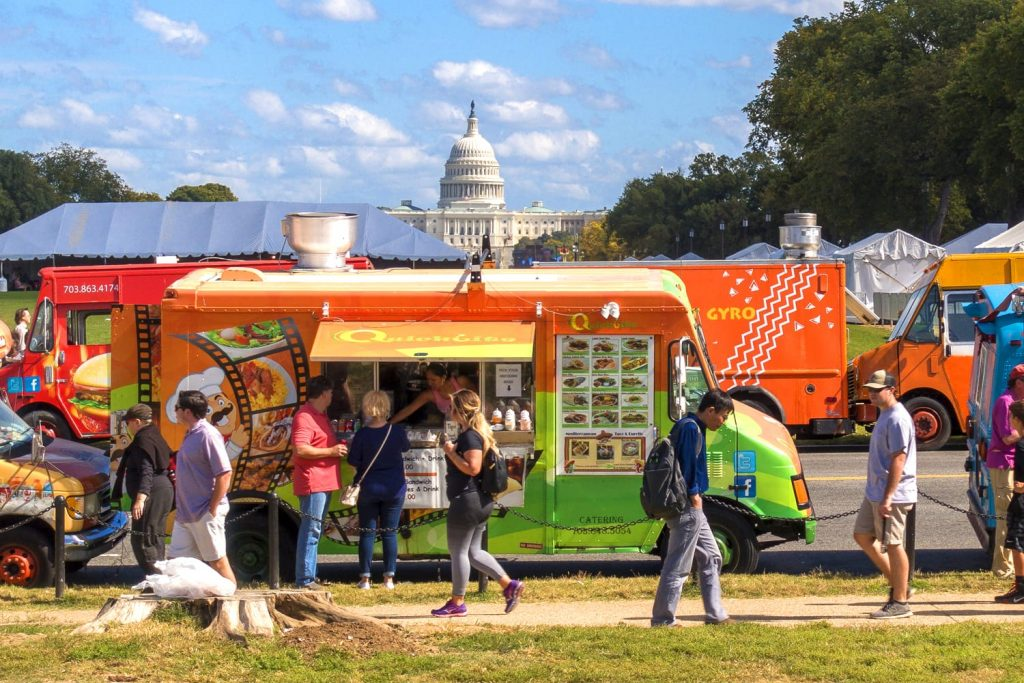 Food trucks and people on the National Mall in Washington DC, USA