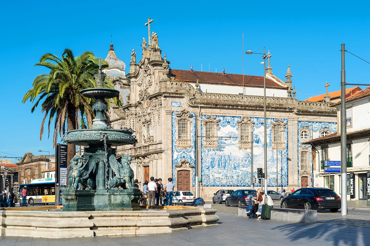 The Gomes Teixeira Square with the fountain of the lions and the Curch of Carmo in Porto, Portugal