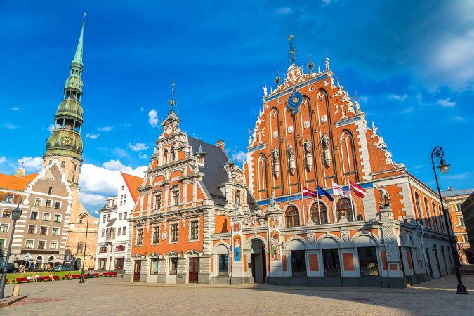 House of the Blackheads and Saint Peters church in Riga in a beautiful summer day, Latvia