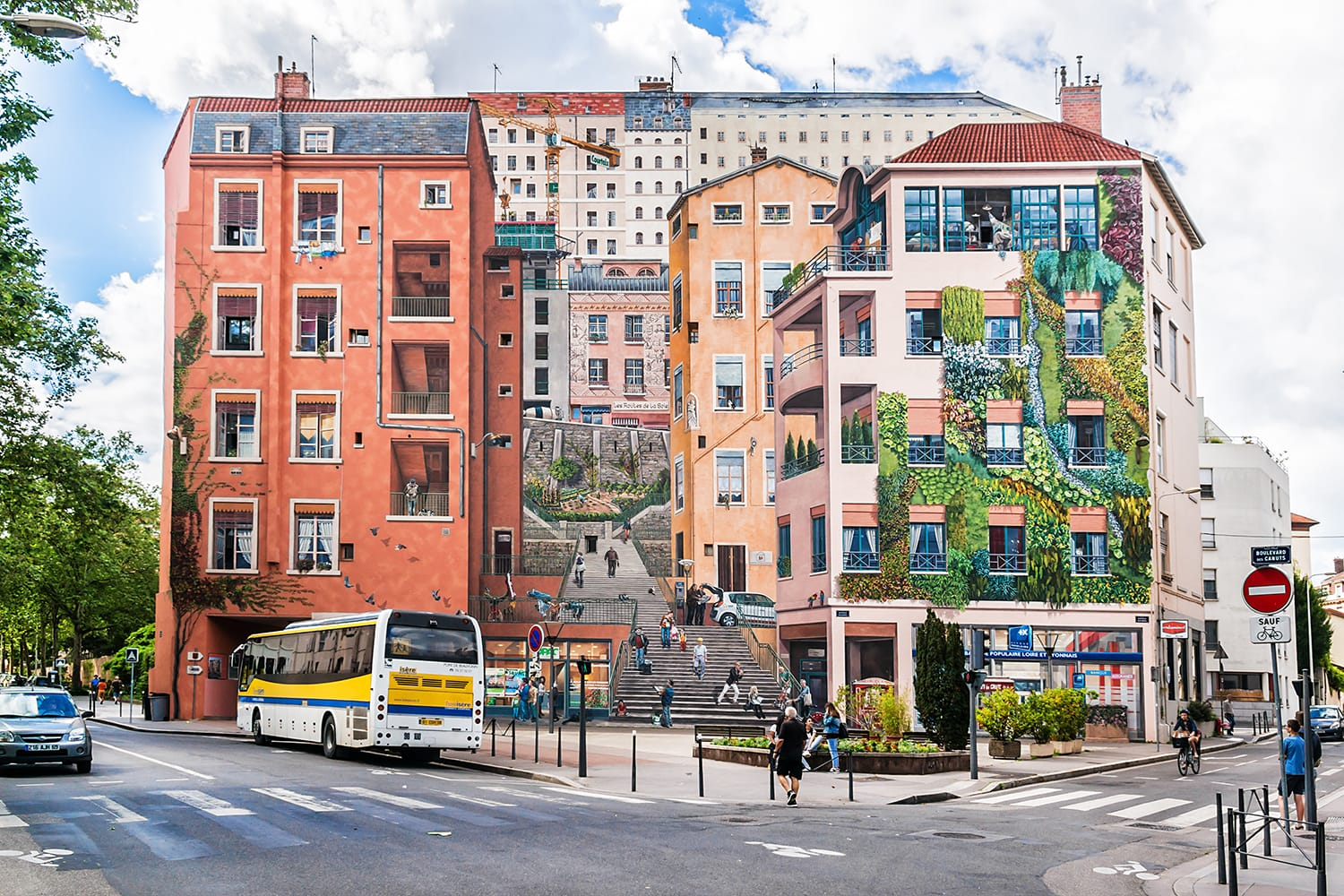 """Mur des Canuts"" (1987) in the Croix-Rousse district. The huge mural is a realistic painting of a Lyon scene, part of the ""Cite de Creation""."
