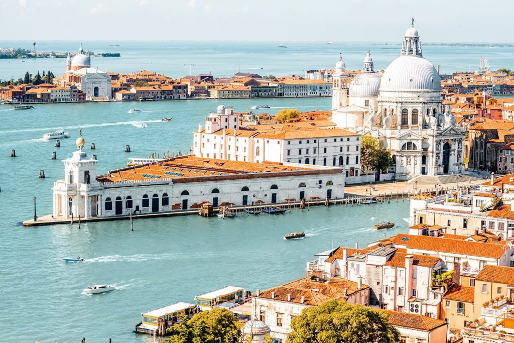 Aerial cityscape view on Venice old town with Santa Maria basilica at the sunny day