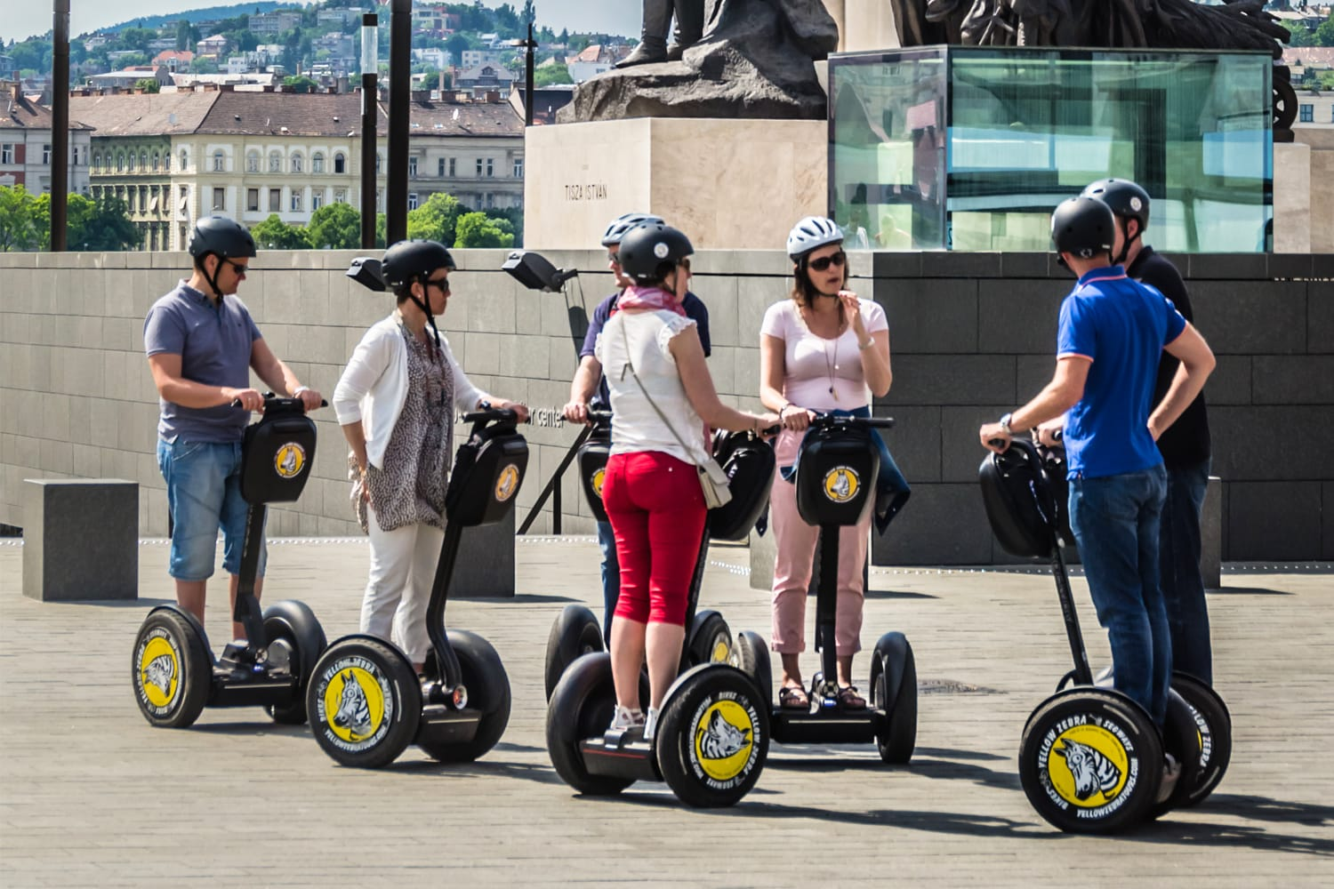 Group of tourists on Segway electric vehicles outside the Hungarian Parliament building in central Budapest, Hungary