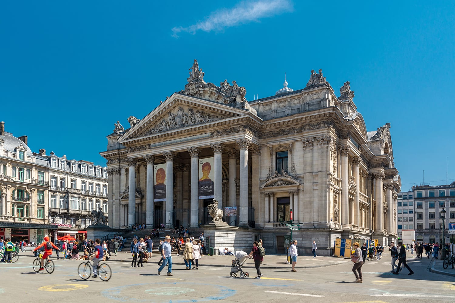 People walking on the pedestrian zone near the Brussels Stock Exchange. The building is usually called simply the Bourse and is located on Boulevard Anspach. Brussels, Belgium
