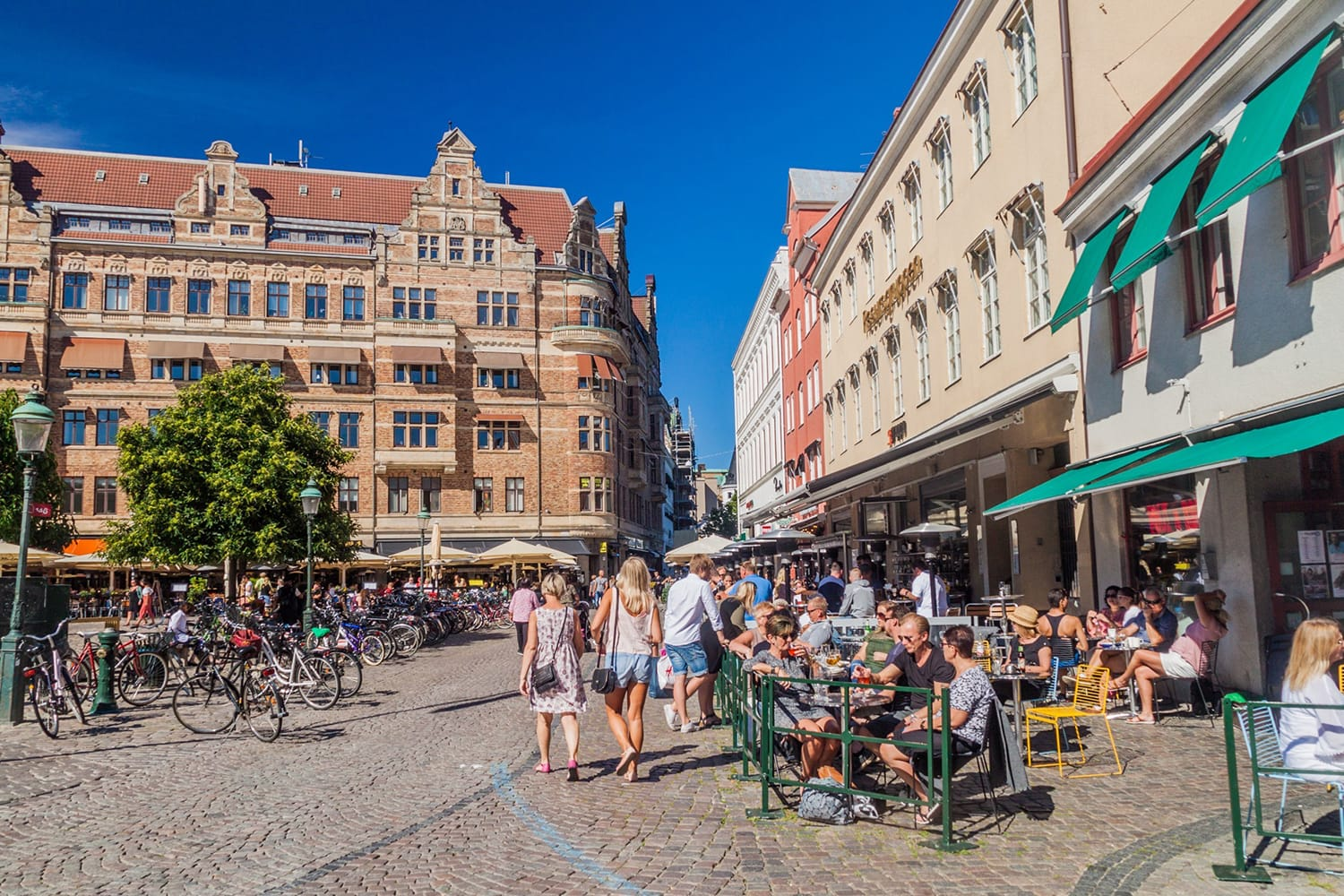 People enjoy a sunny day at Stortorget square in Malmo, Sweden