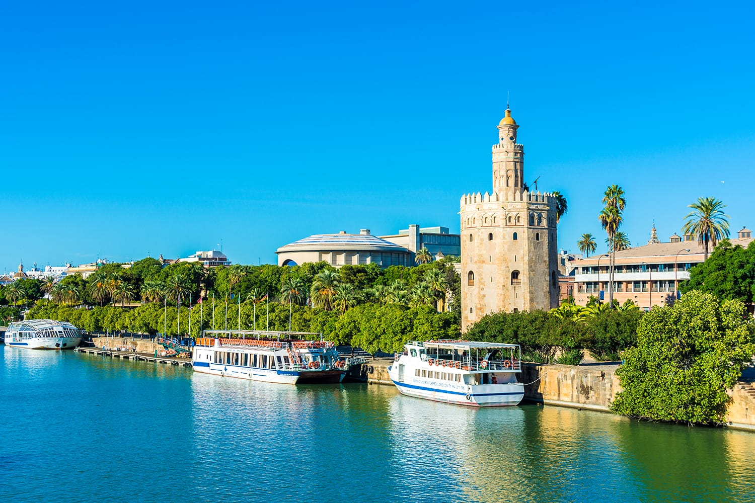 The Torre del Oro in Seville is an albarrana tower located on the left bank of the Guadalquivir River. It houses the Naval Museum of Seville, Spain