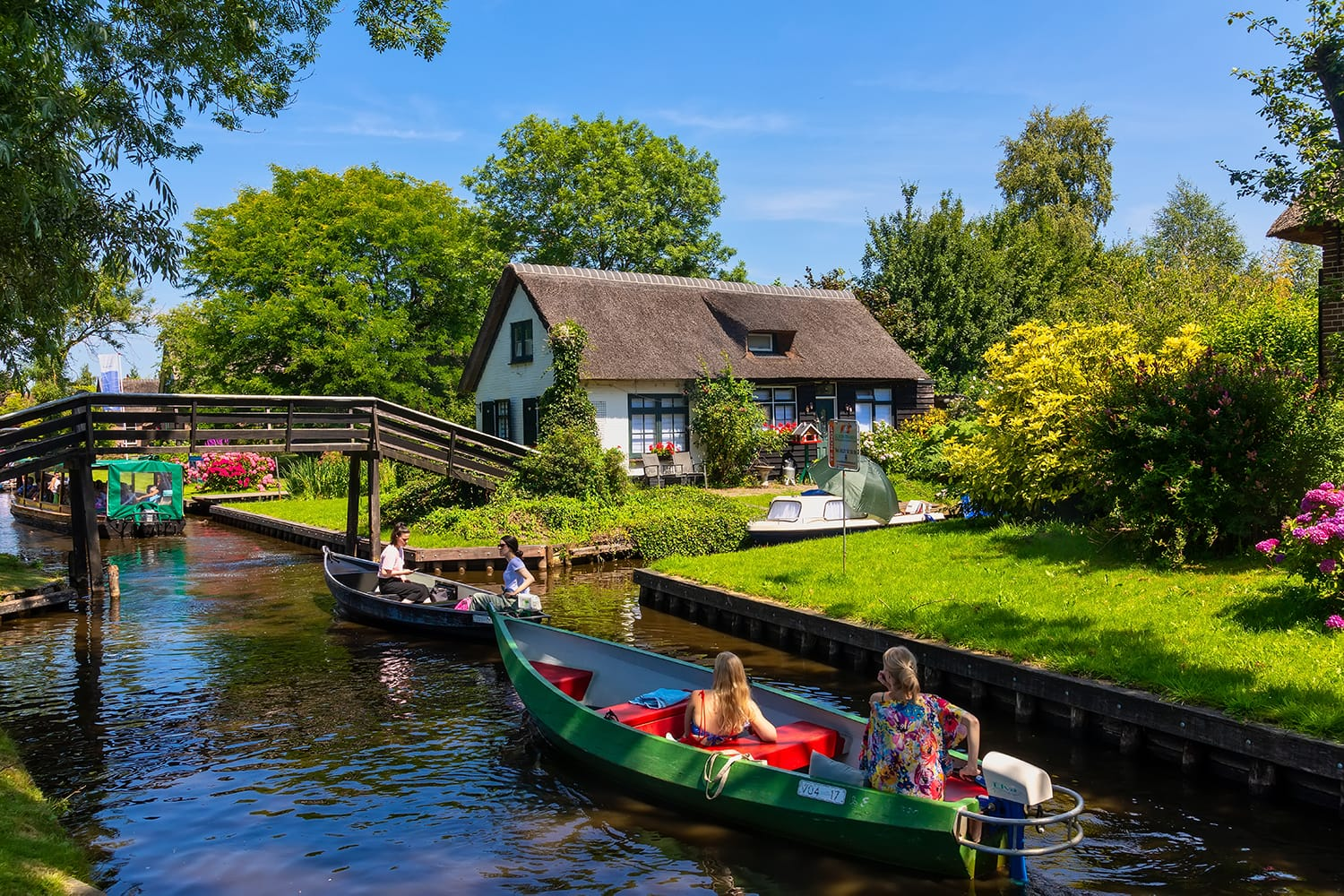 view of famous village Giethoorn with canals in the Netherlands. Giethoorn is also called 'Venice of The Netherlands'