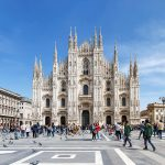 Duomo Milan with tourists and blue sky