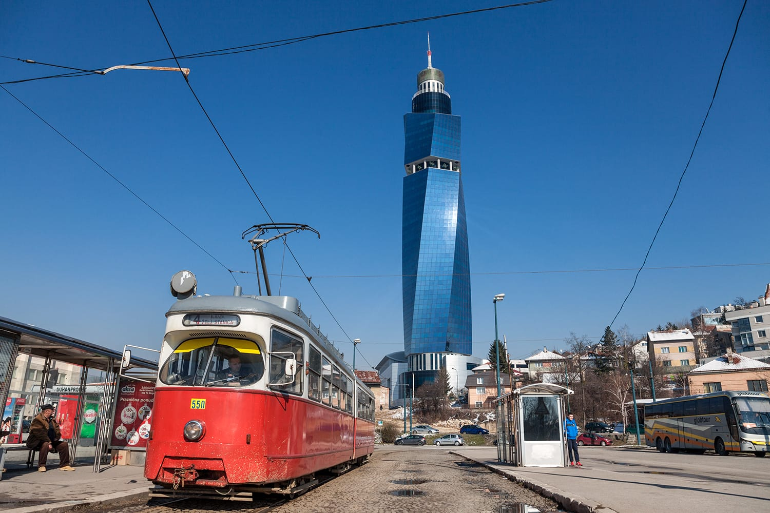 Tram ready for departure on the train station stop, the Avaz Twist Tower is seen in the background. Sarajevo, Bosnia & Herzegovina