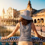 Woman admiring Plaza de Espana (Spain Square). Built on 1928, it is one example of the Regionalism Architecture mixing Renaissance and Moorish styles. Seville, Spain