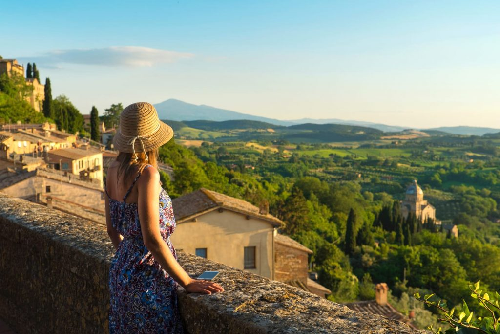 Montepulciano, Tuscany, Italy, Girl looks at the landscape of the city and countryside from the balcony