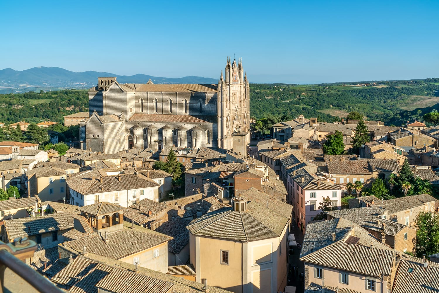 View on historic Duomo di Orvieto, Orvieto Cathedral from the Torre del Moro tower Italy