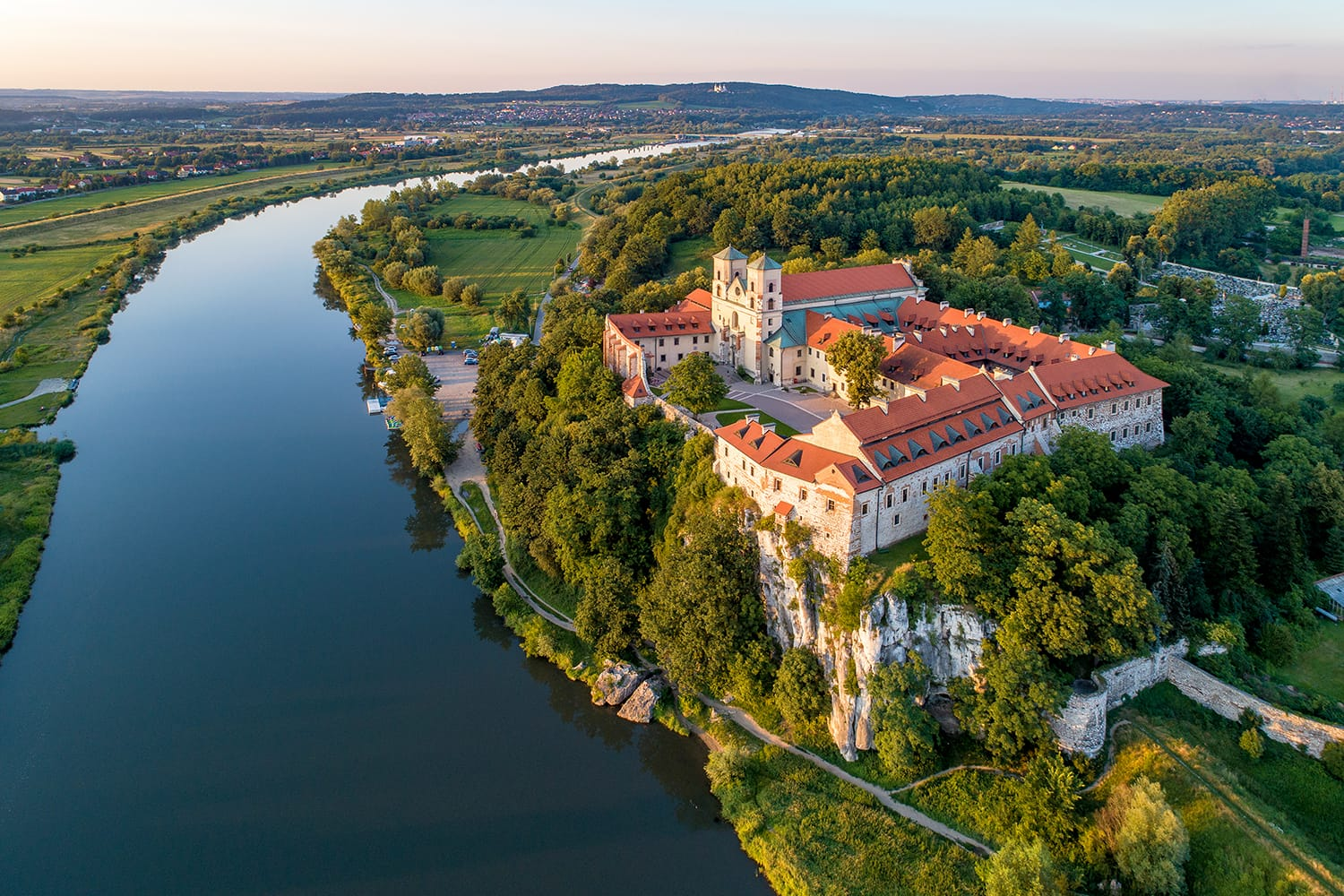 Tyniec near Krakow, Poland. Benedictine abbey, monastery and church on the rocky cliff and Vistula river.