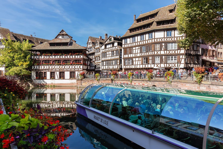 Boat cruise passing through La Petite in Strasbourg, France