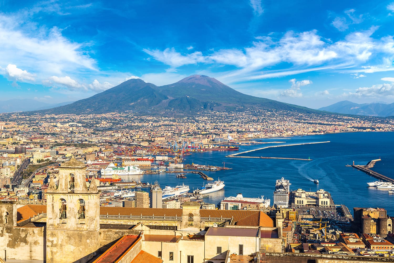 Napoli (Naples) and mount Vesuvius in the background at sunset in a summer day, Italy