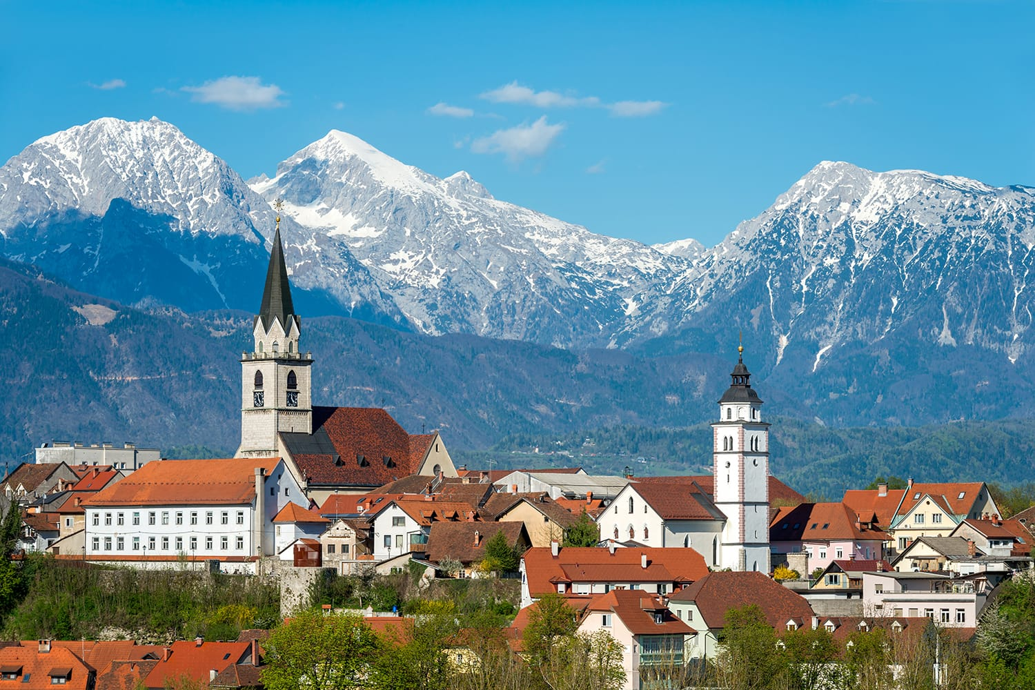 Panorama view Kranj in Slovenia with St. Cantianus Church in the foreground and the Kamnik Alps in the background