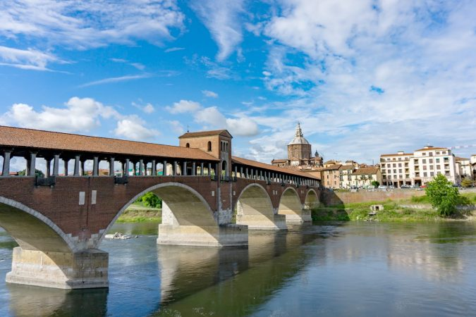Ponte coperto ( covered bridge ) or Ponte Vecchio over Ticino river in Pavia, Lombardy, Italy