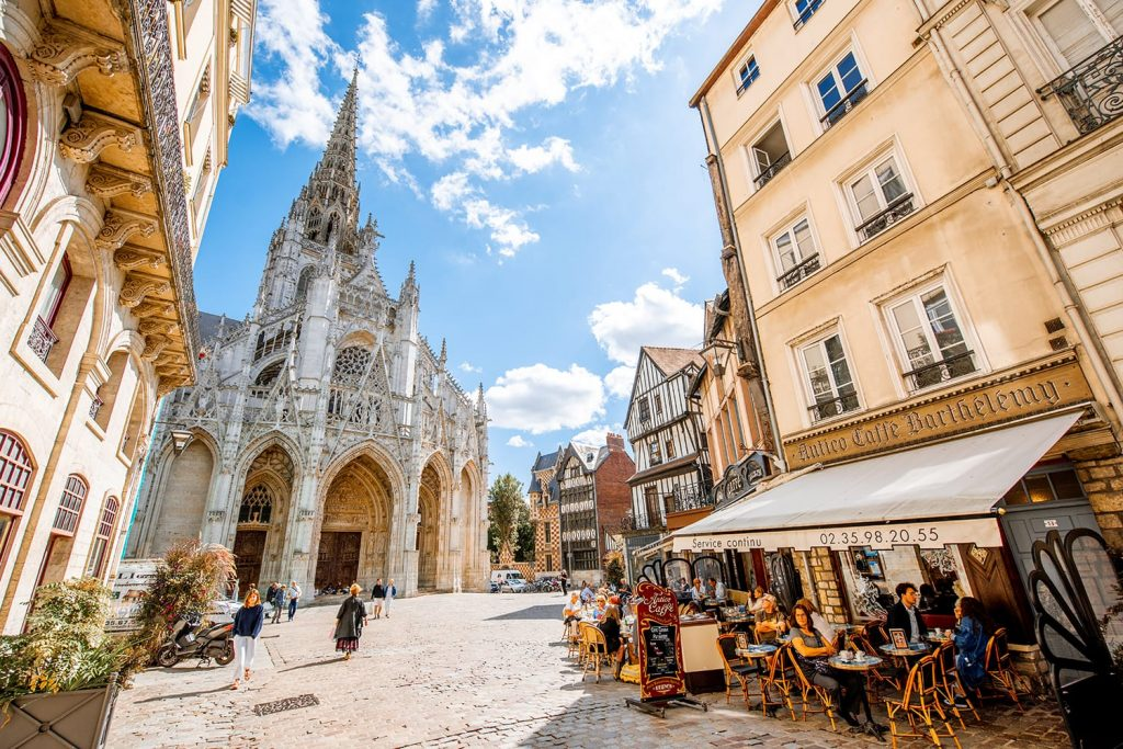 Street view with saint Maclou gothic cathedral during the sunny day in Rouen, France