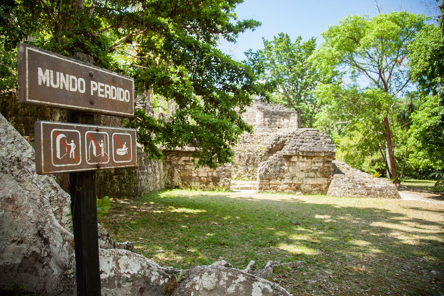 Sign at the entrance to the complex of astronomic conmmemoration known as Plaza of the Great Pyramid or Lost World (Mundo Perdido) in Tikal, Guatemala.
