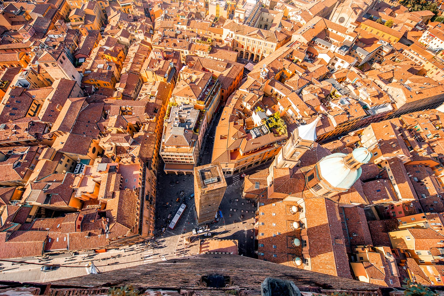 Aerial cityscape view from the tower on Bologna old town with Garisenda tower and roman catholic church