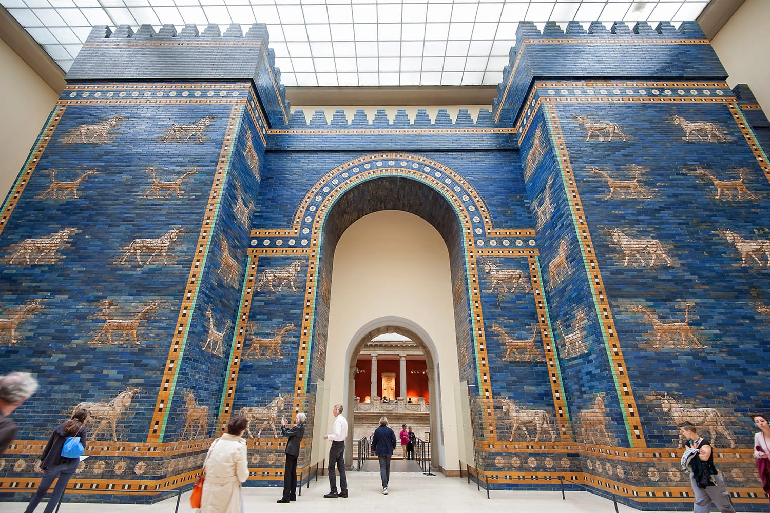 Tourists in front of Babylonian city wall at the Pergamon museum in Berlin, Germany