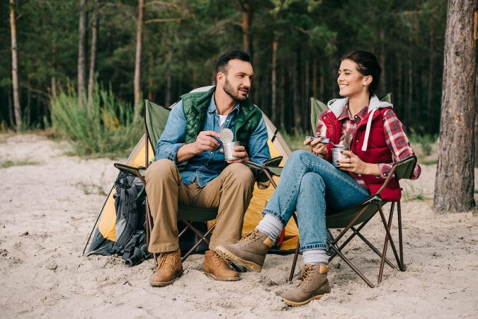 Couple sitting in camping chairs