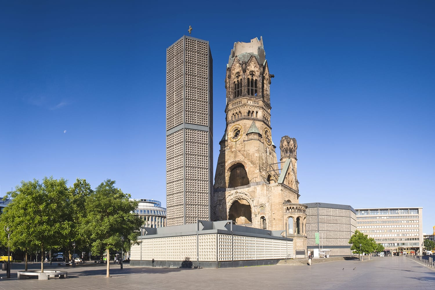 Kaiser-Wilhelm-Kirche, broken spire and modern bell tower overlook the busy Breitscheidplatz as symbols of the city's regeneration.