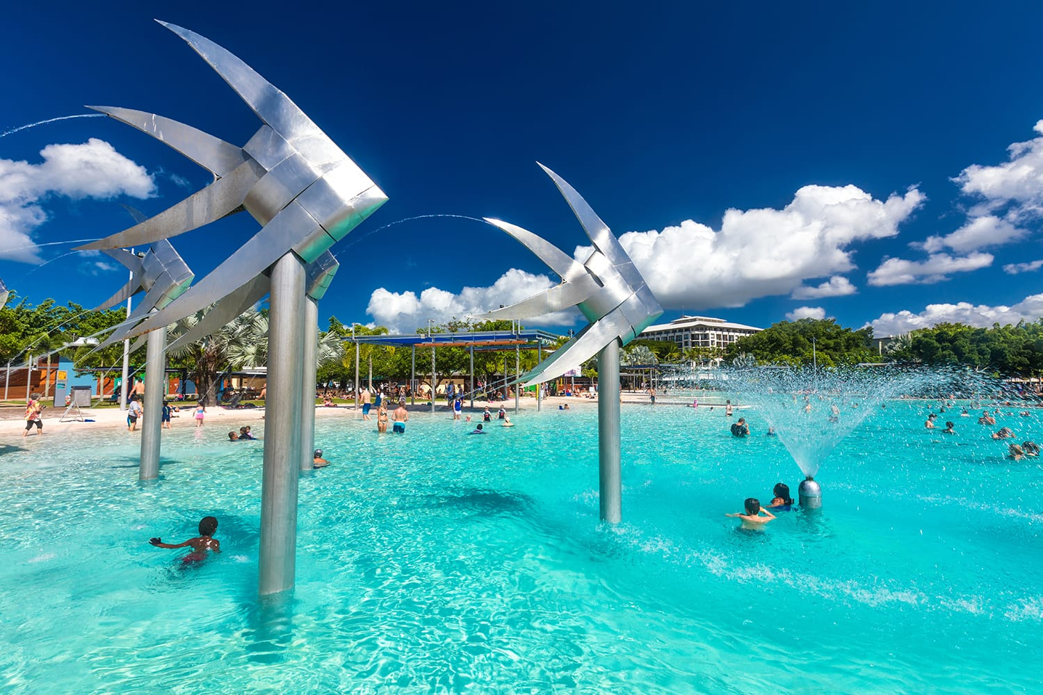 Tropical swimming lagoon on the Esplanade in Cairns with artificial beach; Queensland; Australia.