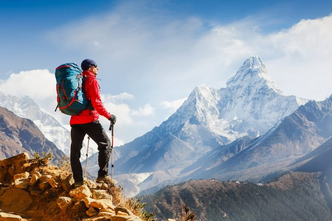 Active hiker with backpack enjoying the view. Himalayas. Nepal