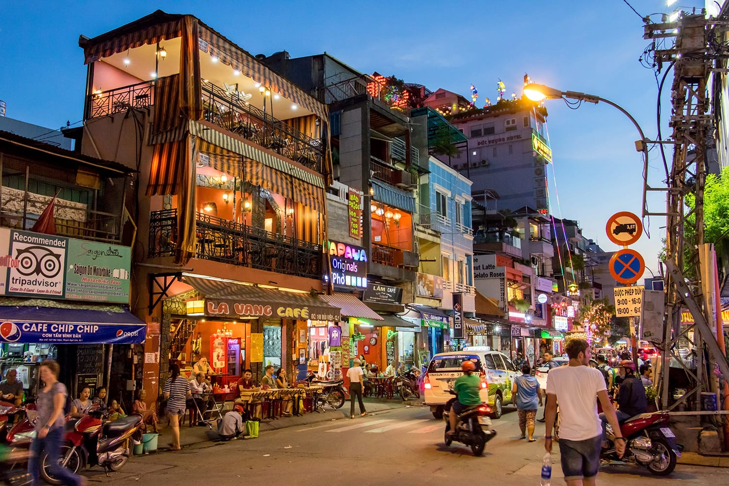 Evening Street with bars and pubs in the center of Ho Chi Minh city, Vietnam