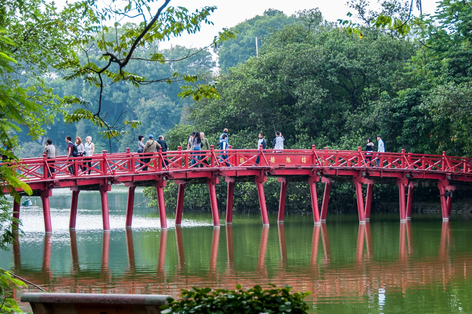 The Duc, a wooden bridge painted in red, which leads to the Ngoc Son Temple in Hanoi, Vietnam
