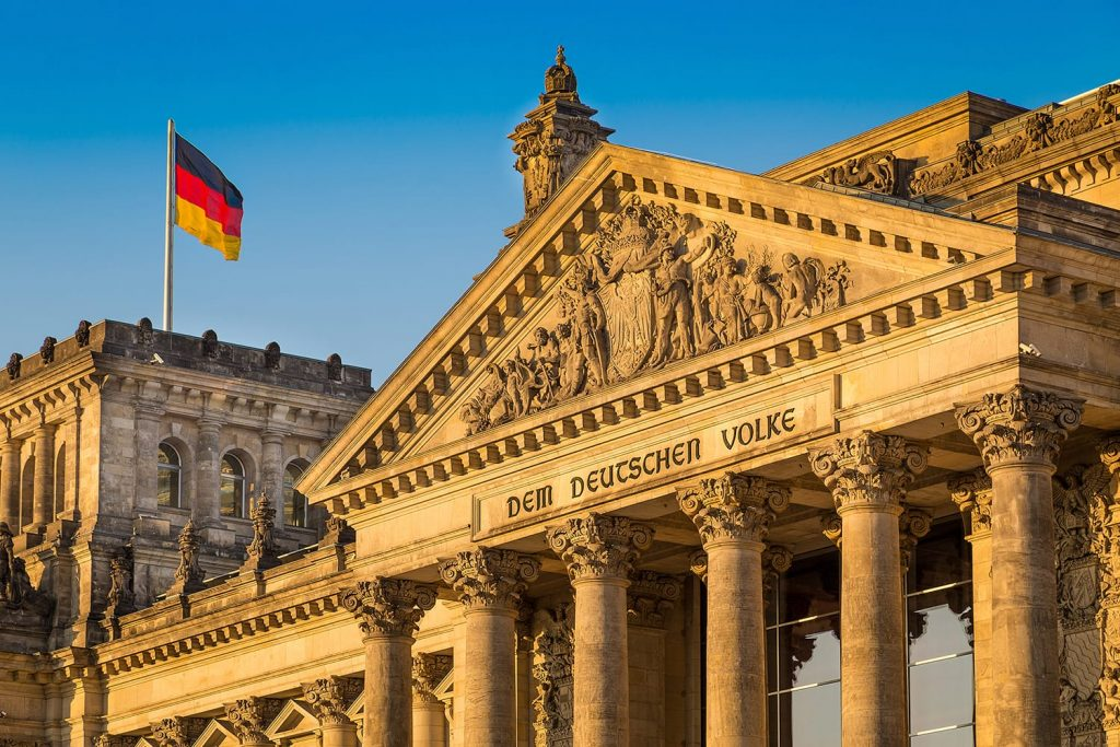 Close-up view of famous Reichstag building, seat of the German Parliament (Deutscher Bundestag), in beautiful golden evening light at sunset, Berlin Mitte district, Germany