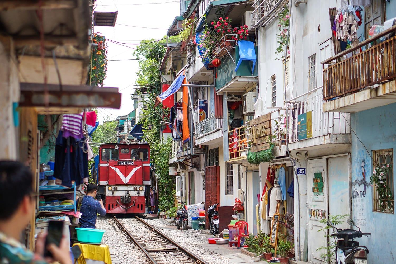 A train running through ancient town in Hanoi.