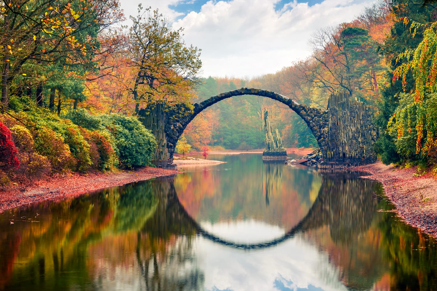 Rakotz Bridge (Rakotzbrucke, Devil's Bridge). Unbelievable morning scene of Azalea and Rhododendron Park Kromlau, Germany, Europe