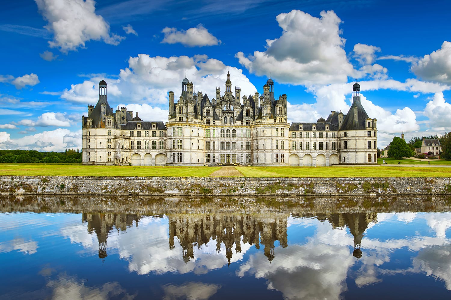 Chateau de Chambord, royal medieval french castle and reflection. Loire Valley, France