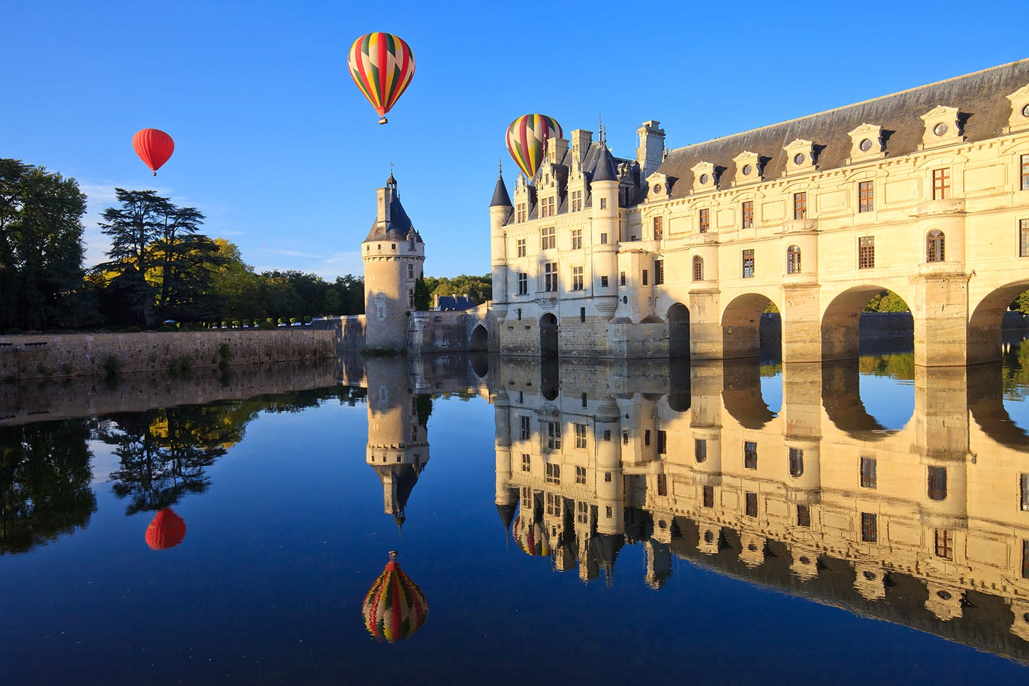 Hot air balloons over Chateau de Chenonceau in the Loire Valley, France