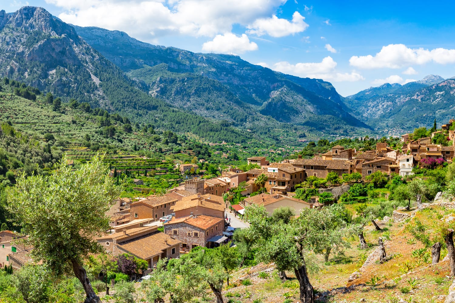 Idyllic panorama view of old village Fornalutx with beautiful mountain landscape of Sierra de Tramuntana on Mallorca, Spain