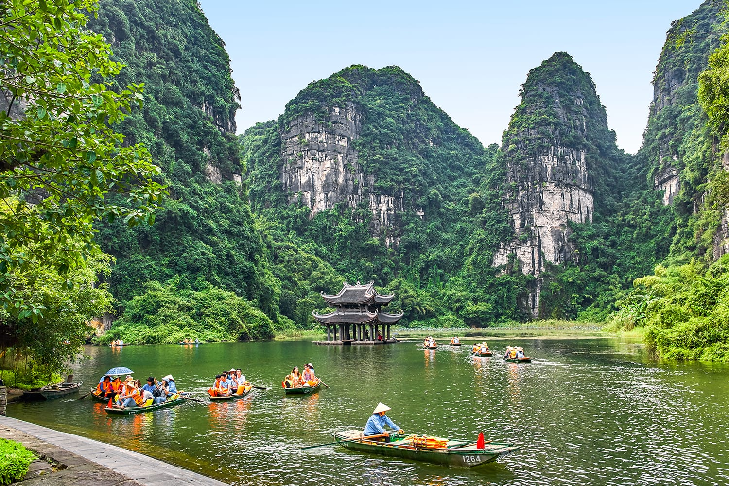 Rowboats with beautiful water temple view in Trang An, Ninh Binh, Vietnam