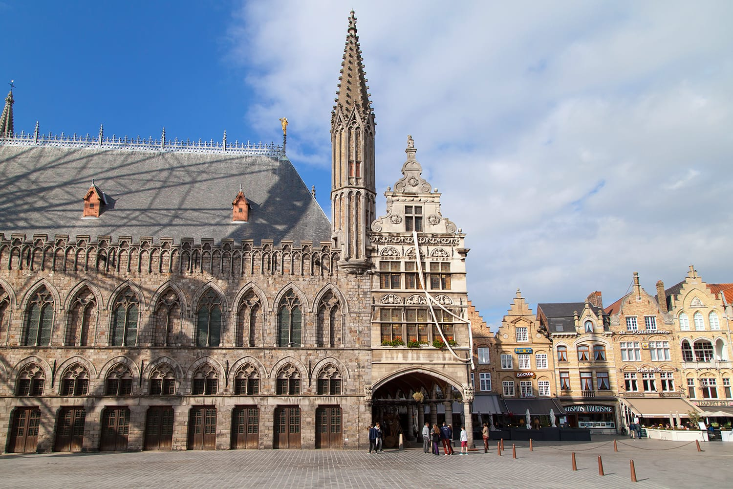 Grote Markt of Ypres, Belgium, with part of the Cloth Hall building on the left and the renaissance building Nieuwerck on the center
