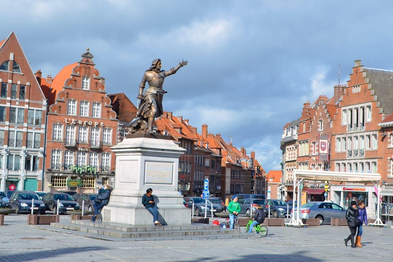 View of the people passing grote markt - main square in Tournai/Doornik, Belgium