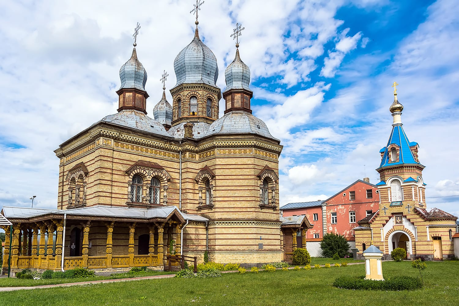 Jekabpils Orthodox Church of The Holy Spirit against bright blue sky. The church was built in the second part of the 19th century in Byzantine style. Its five domes have become a landmark of the city.