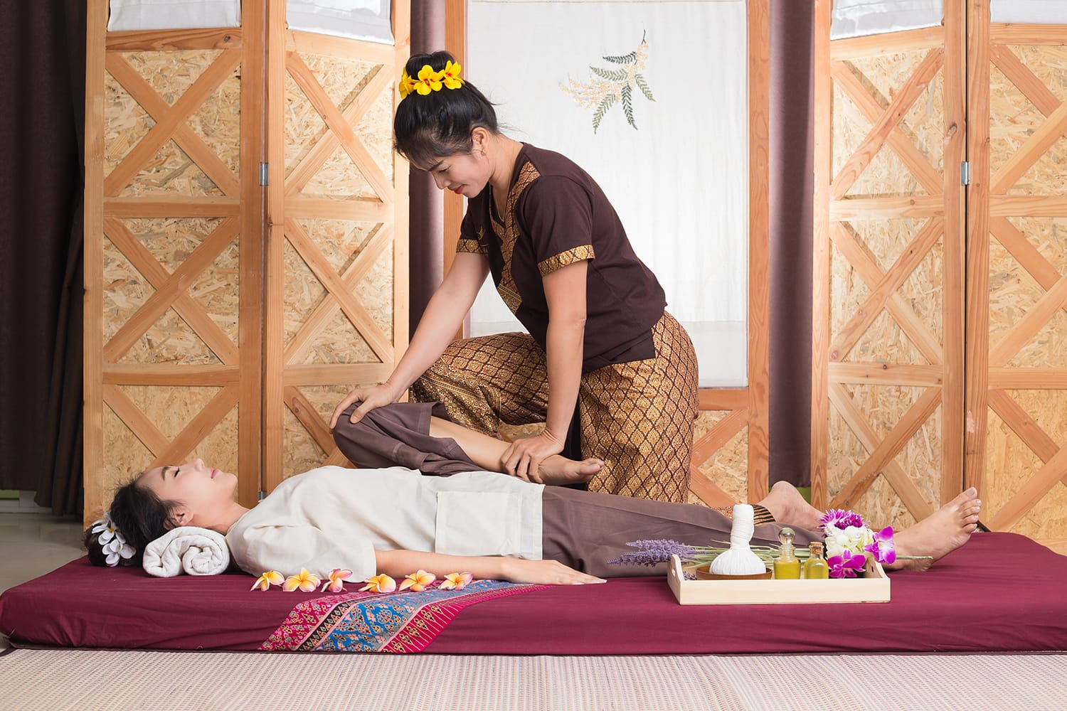 Woman giving Thai massage