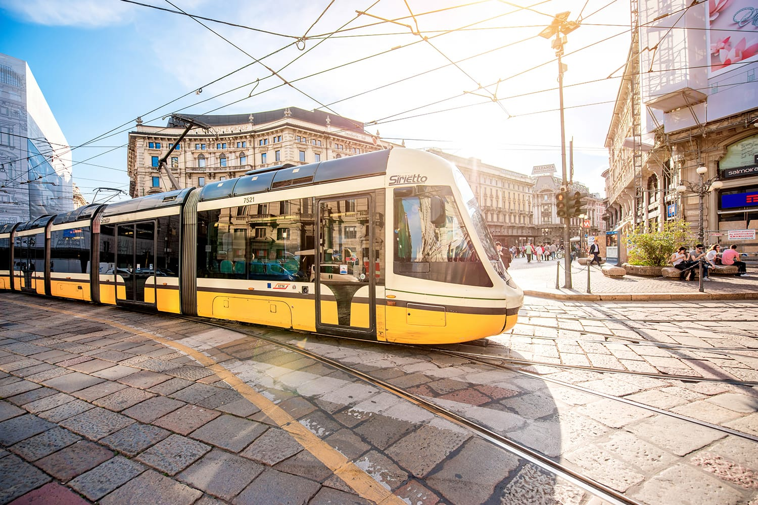 Yellow tram on Cordusio square in Milan, Italy