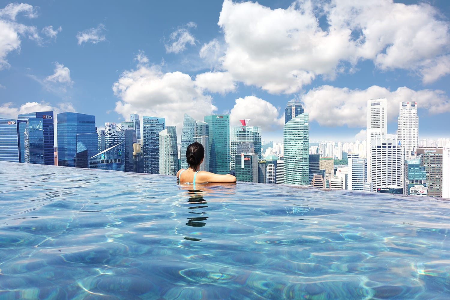 Attractive woman relaxing in Marina Bay Sands infinity swimming pool, Singapore