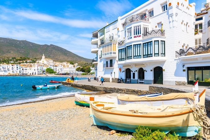 Fishing boats on beach in Cadaques white village, Costa Brava, Spain