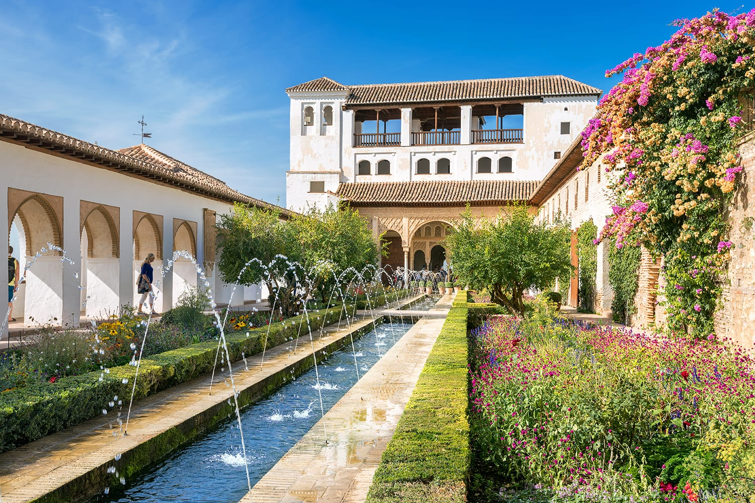 View of Generalife courtyard with fountain in Alhambra palace. Granada, Andalusia, Spain