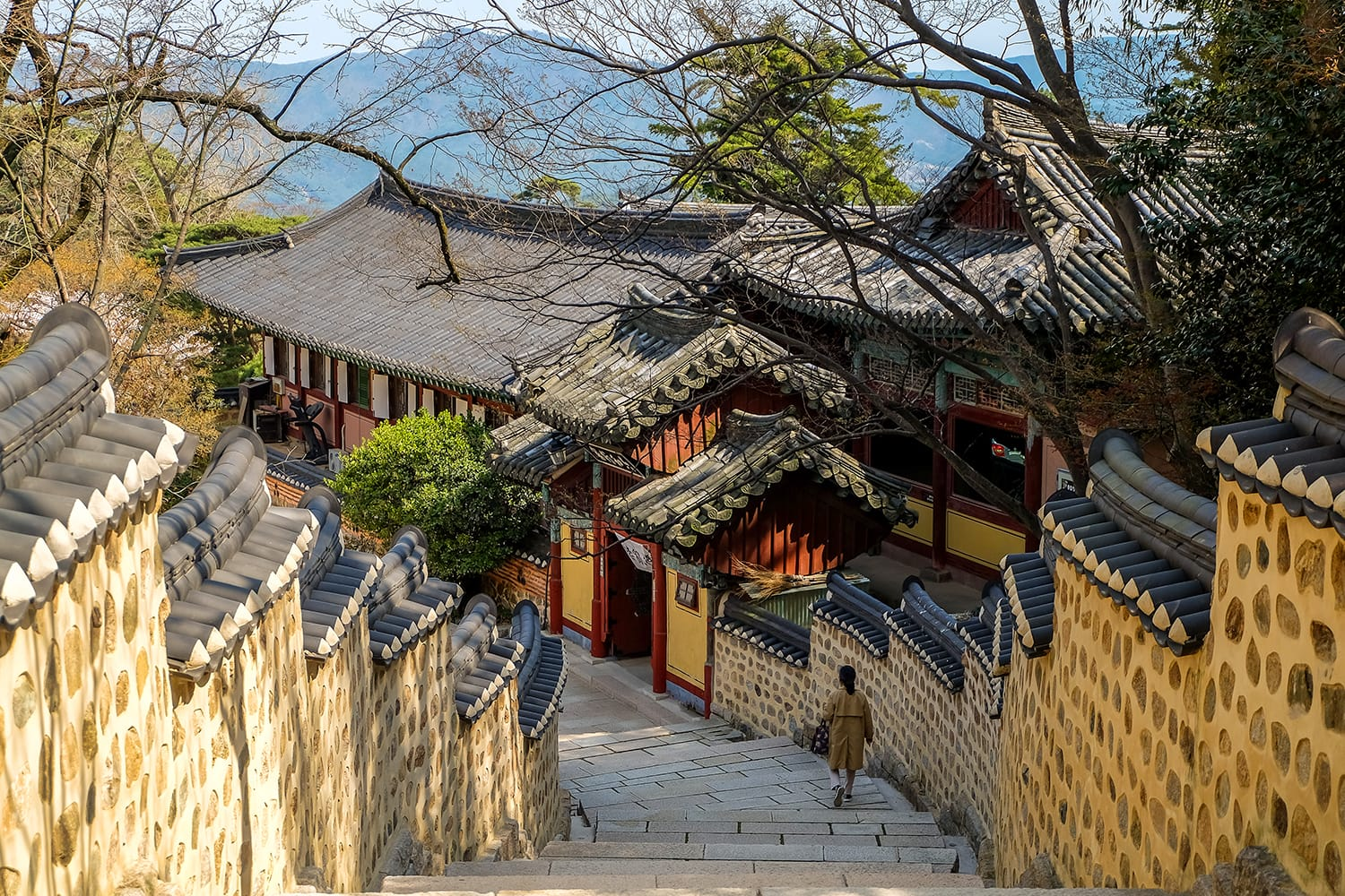 Tourist walk down the stairs in Beomeosa Temple in Busan, South Korea